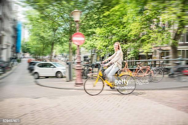 woman tourist cycling on amsterdam