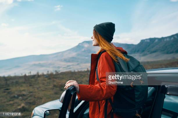 woman tourist in the car looks at the mountains - journey stock pictures, royalty-free photos & images