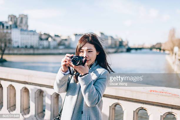 Woman tourist taking picture on street in Paris