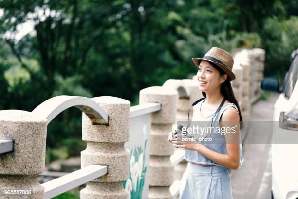 Woman tourist using telescope