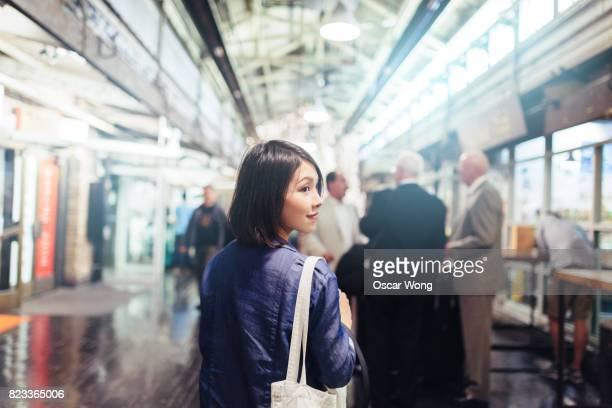 Woman tourist walking in a food market