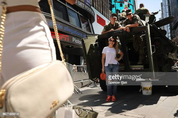 A woman tours a United States Marine military vehicle in Times Square as part of Fleet Week festivities May 24 2018 in New York City Fleet Week which...
