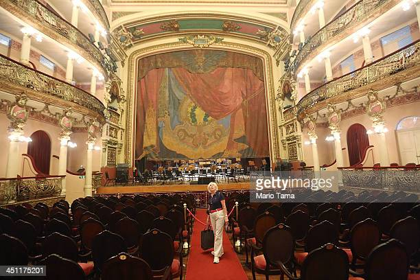 A woman tours the famed Teatro Amazonas opera house on November 21 2013 in Manaus Brazil The opulent venue was built during the rubber boom in Manaus...