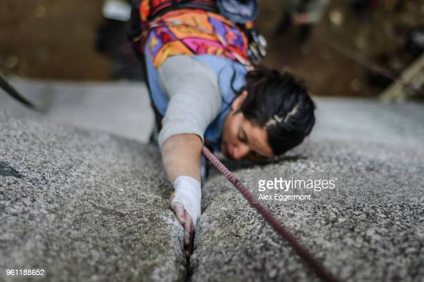 Woman trad climbing at The Chief, Squamish, Canada