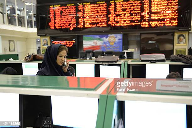A woman trader seen on the phone in Tehran Stock Exchange trading floor on December 4 2013 in Tehran Iran