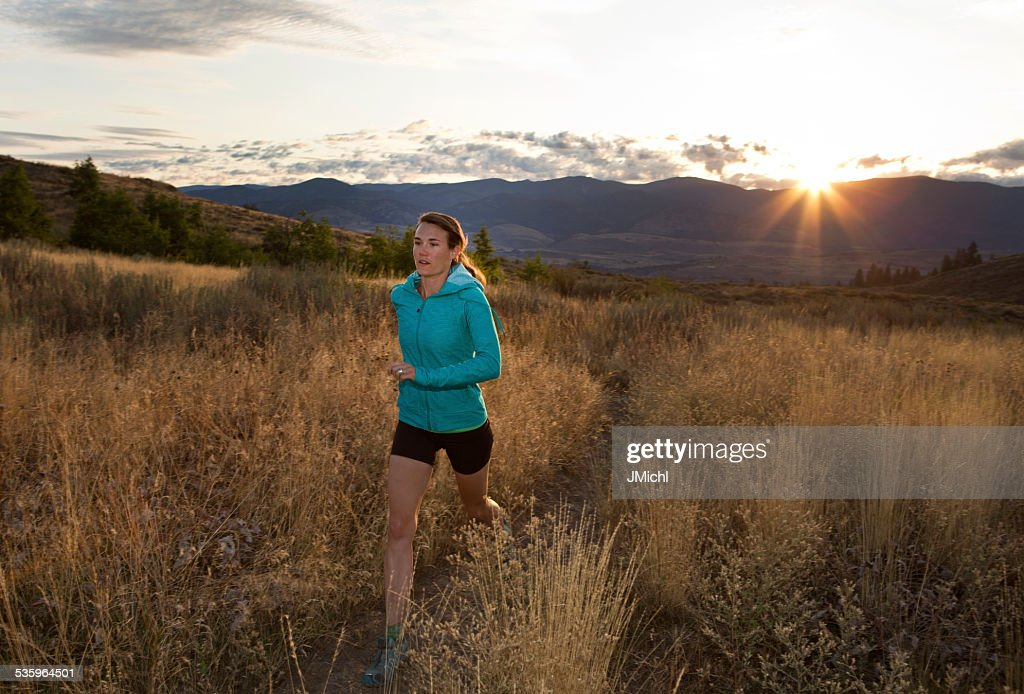 Woman Trail Running At Sunrise in The Mountains. : Stock Photo