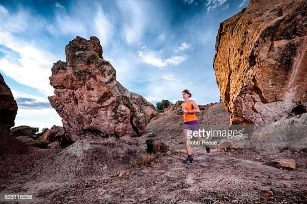 woman trail running in desert, grand junction, colorado, usa - robb reece stock-fotos und bilder