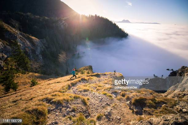 woman trail running in the mountains, salzburg, austria - dramatic landscape stock pictures, royalty-free photos & images