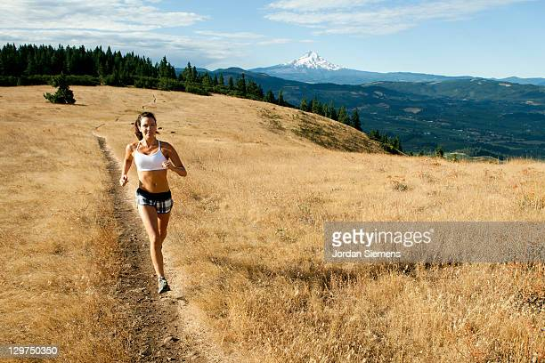 woman trail running. - mt hood stock pictures, royalty-free photos & images