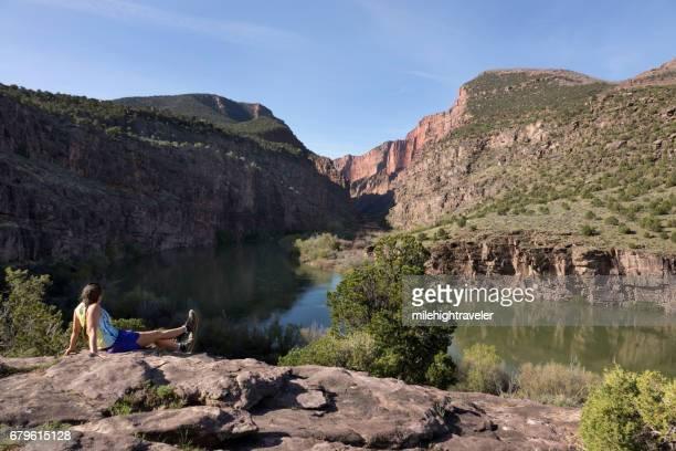 Woman trail runs Gates of Lodore Green River canyon Dinosaur National Monument Colorado