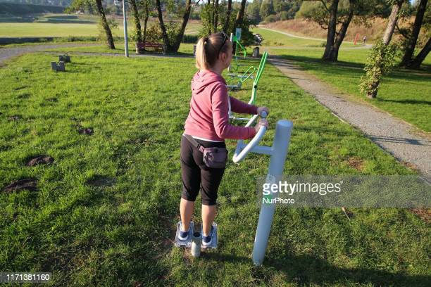 Woman training in a public openair gym on a recreation area in Gdansk Kielpinek district Poland on 26 September 2019 According to the...