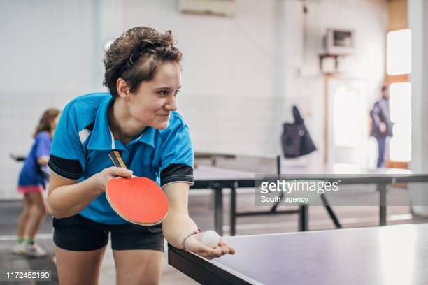 woman training table tennis - serving sport stock pictures, royalty-free photos & images