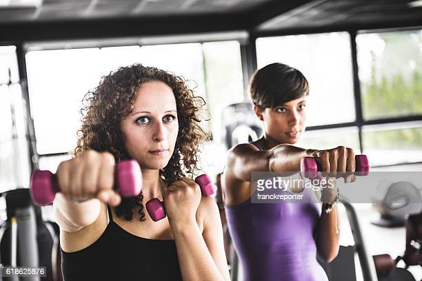 Woman training with dumbbell on gym