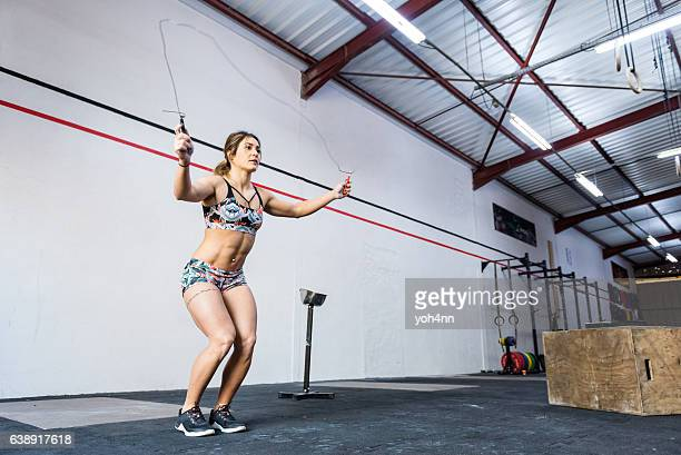Woman training with skipping rope