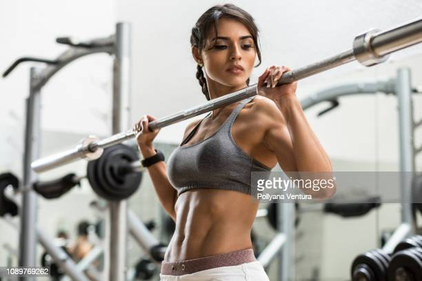 woman training with weight - body building stock pictures, royalty-free photos & images