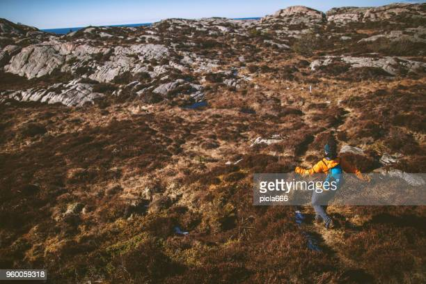 woman travel adventures: mountain hiking in norway - wilderness stock photos and pictures
