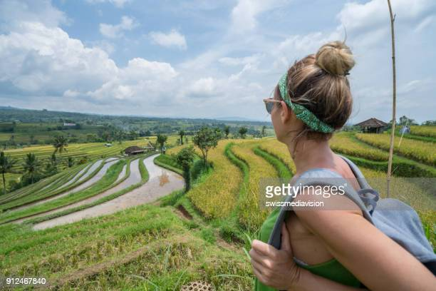 Woman  traveler contemplating rice terraces in Bali