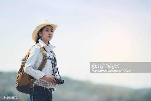woman traveler hiking with backpack at mountains landscape - national landmark stock pictures, royalty-free photos & images