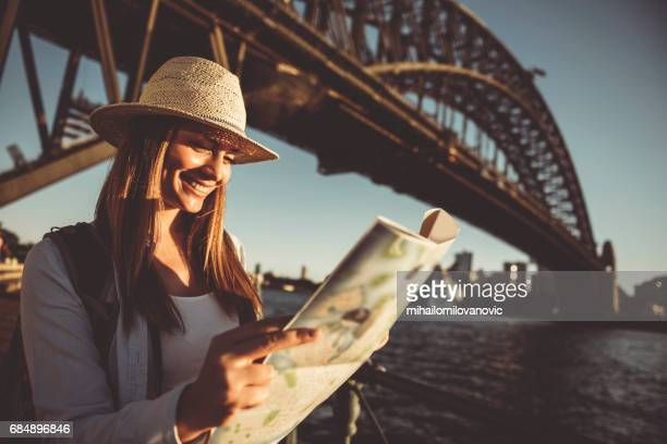 Woman traveler holding city map