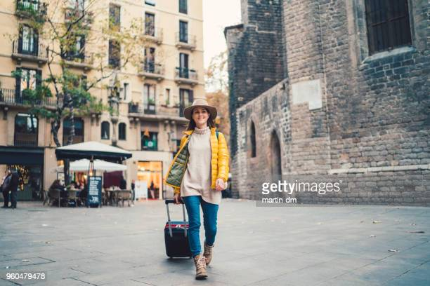Woman traveler walks through the streets of Europe