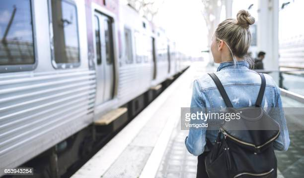 woman traveler with backpack on rail station - railroad station stock pictures, royalty-free photos & images