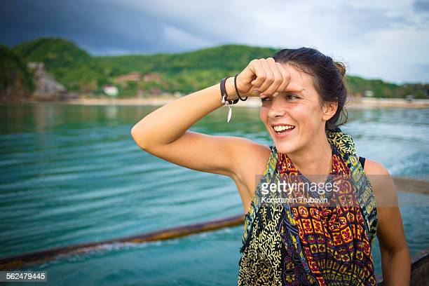 Woman traveling by boat.