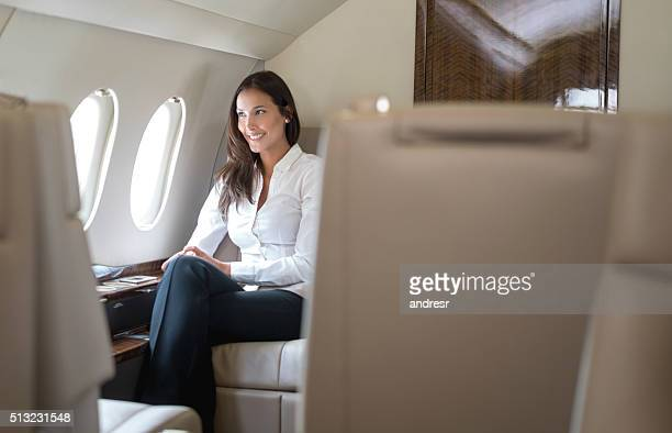 Woman traveling by plane in business class