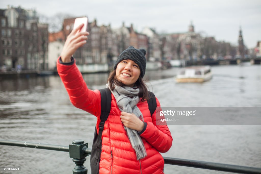 Woman traveling in Amsterdam : Stock Photo