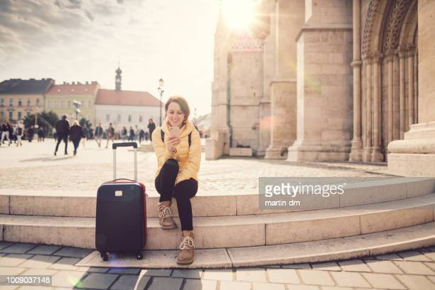 woman traveling in europe - making a reservation stock photos and pictures