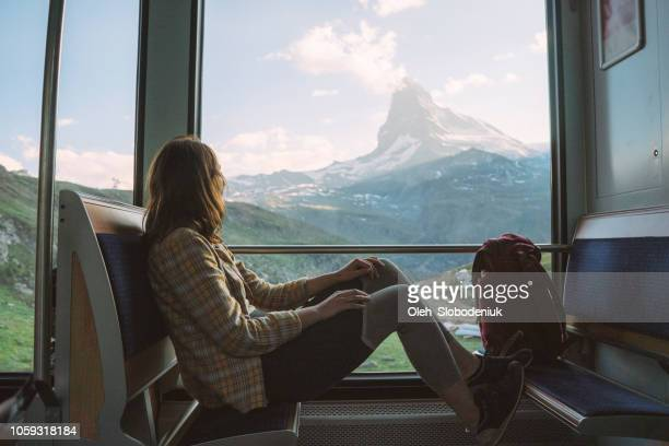 woman traveling in gornergrat train - switzerland stock pictures, royalty-free photos & images