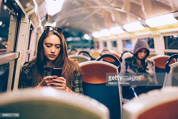 woman traveling to work - tram stockfoto's en -beelden