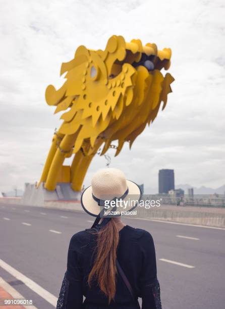 woman traveller looking at the dragon bridge in danang city in vietnam , southeast asia - man made structure stock pictures, royalty-free photos & images