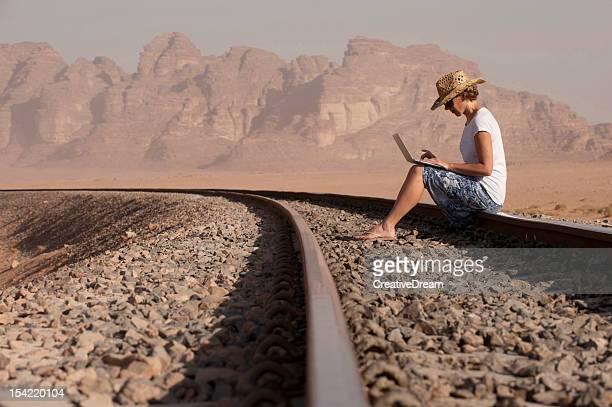 Woman traveller using laptop