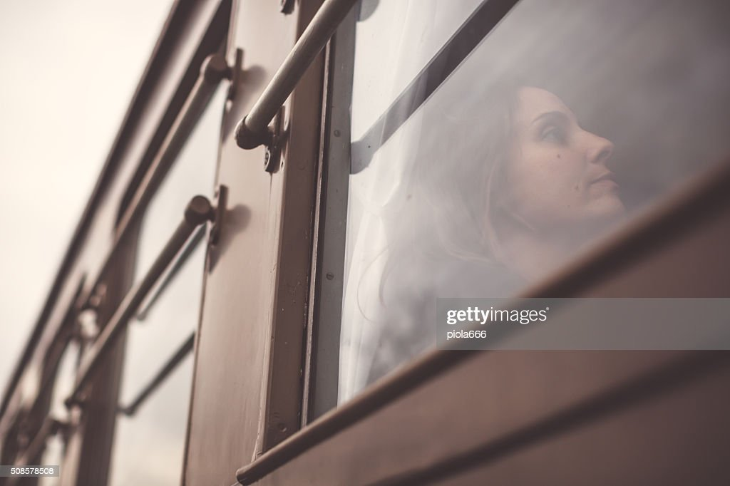 Woman travelling alone in a train : Stock Photo