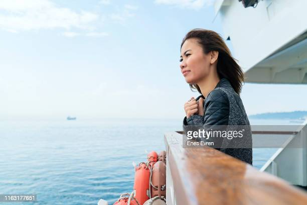 woman travelling by ferry, getting away from it all - hope concept - ferry stock pictures, royalty-free photos & images