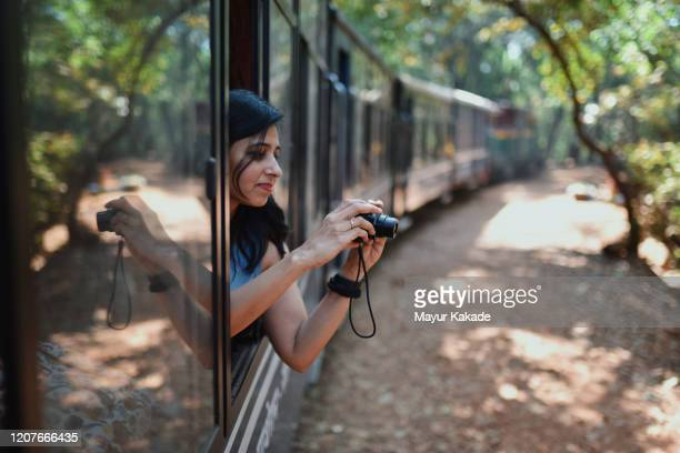 woman travelling by tourist train - photographer stock pictures, royalty-free photos & images