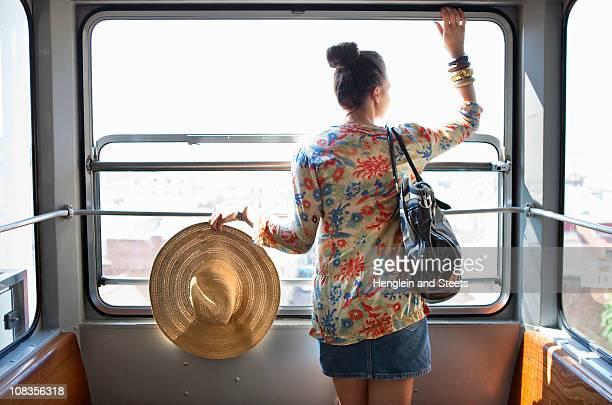 woman travelling in funicular train - overhead cable car stock pictures, royalty-free photos & images
