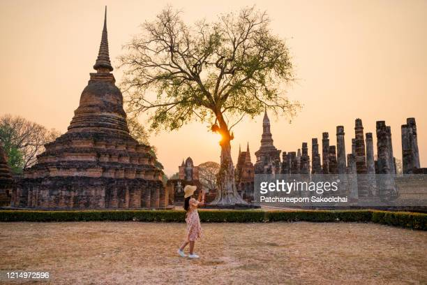woman travelling in historical park - ayuthaya province stock pictures, royalty-free photos & images