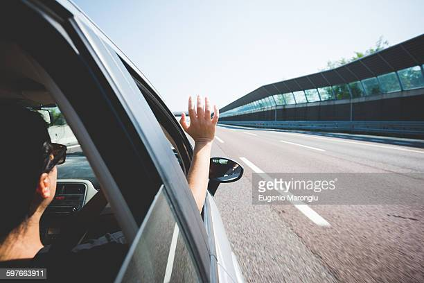 Woman travelling on highway, Garda, Italy