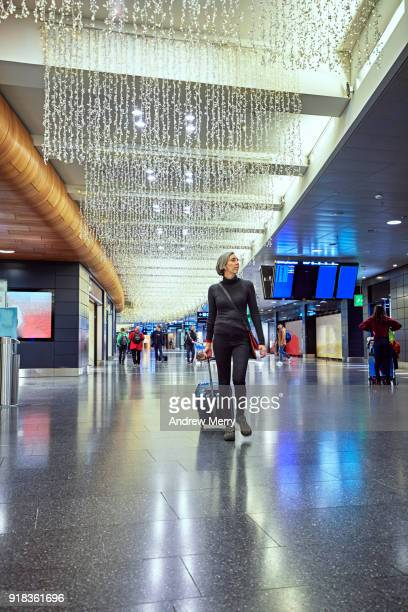 woman travelling through zurich airport at night, switzerland - duty free stock pictures, royalty-free photos & images