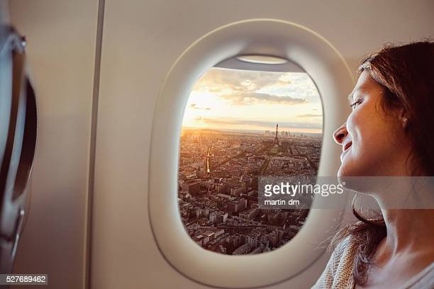 woman travelling to paris - aeroplane stock pictures, royalty-free photos & images