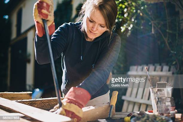 woman treating a europallet - home improvement stock pictures, royalty-free photos & images