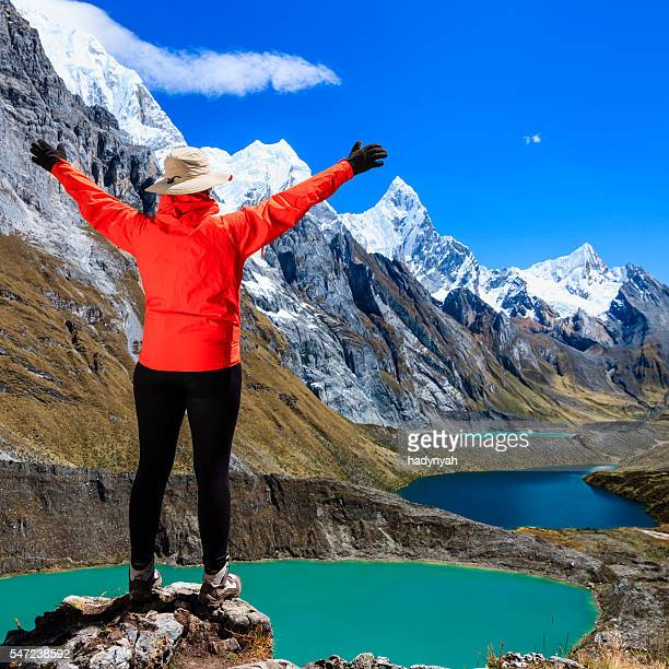 woman trekking near tres lagunas in peruvian andes, south america - três pessoas stock pictures, royalty-free photos & images