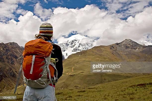 A woman trekking through the Himalayas in Bhutan.