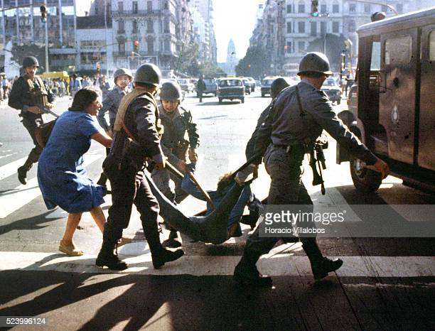 Woman tries desperately to prevent detention of a young man by police during anti-government rally in Buenos Aires during the last days of...