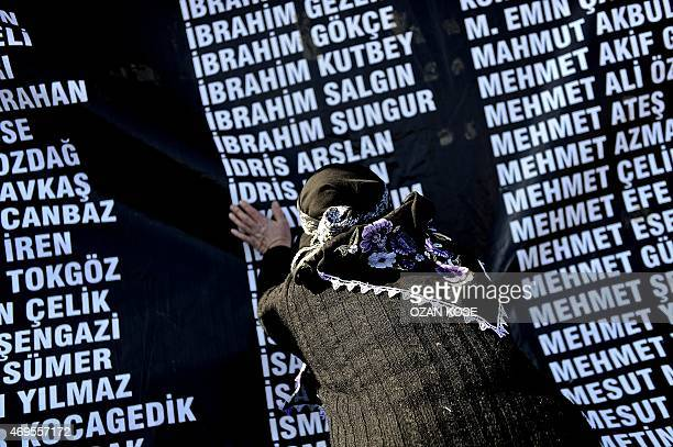 Woman tries on April 13, 2015 to find the name of her dead husband on a list, bearing the names of the 301 killed miners last year, at a special...