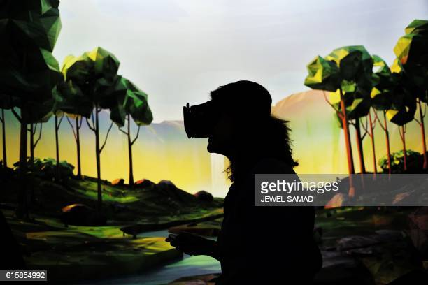 TOPSHOT A woman tries on Google's virtual reality device 'Daydream View' after the opening of Google's popup store in New York on October 20 2016...