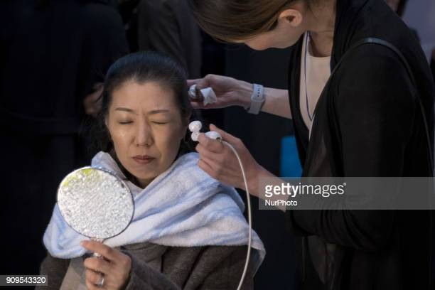 Woman tries out a Air Brush Make Up machine during the Cosme Tokyo 2018, January 24, 2018 in Japan. Cosme Tokyo 2018 and the Asia's leading...