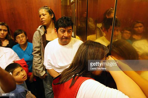 A woman tries to breathe fresh air through a crack in the doors when homeowners and ACORN activists become stuck in an elevator as they visit the new...