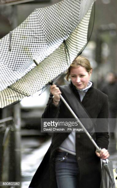 A woman tries to control her umbrella in heavy storms in the centre of Edinburgh as Scotland is hit again by bad weather Scotland and the west took...